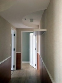 Hallway with designer ceiling and LED lighting